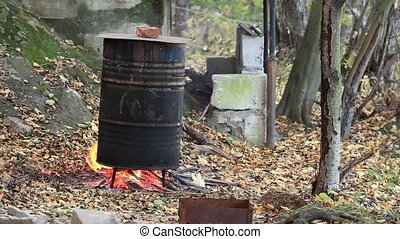 cooking fish smoking in a barrel