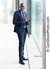 modern african businessman using tablet computer in office