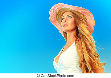 towards a dream - Beautiful young woman in elegant hat...