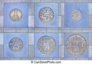 Collection of former Dutch coins in pavement - Collection of...