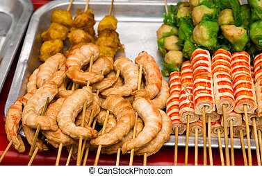 Asian snack with crab meat on a tray of outdoor street food...