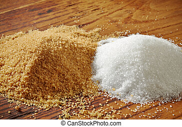 brown and white sugar on wooden table