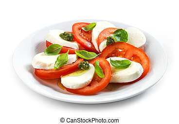 tomato and mozzarella salad on white plate