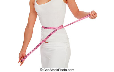 Woman with a tape measure measuring her waist
