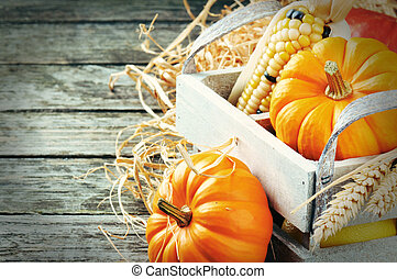 Autumn harvest setting with pumpkins