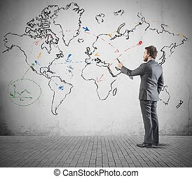 Global business concept with businessman that draws a world...