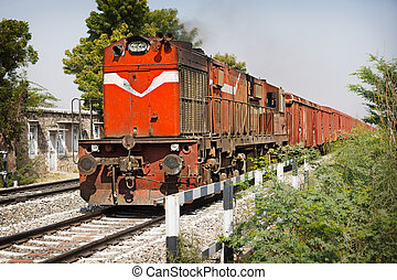Old locomotive pulling freight train. India