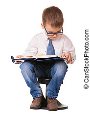 Cute clever kid in glasses read note book