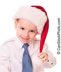Little funny boy in red santa hat