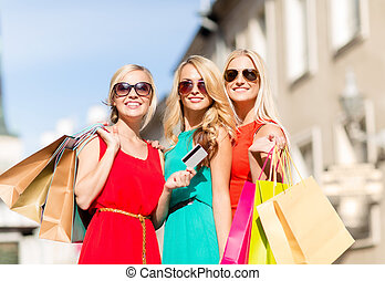 beautiful women with shopping bags in the ctiy - sale and...