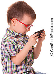 Clever kid is playing with smart cell phone - Clever kid is...