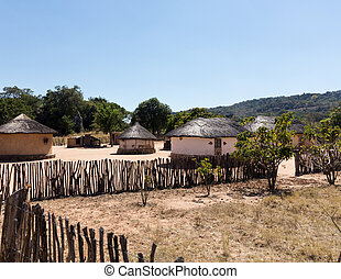 Typical tribal village in Zimbabwe - View of thatched mud...