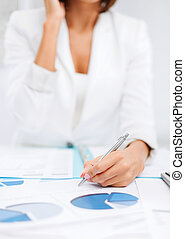 woman with documents taking phone call - business, office,...