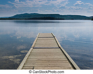 Wooden dock on a beautiful calm Yukon lake Canada - Empty...