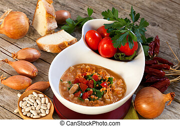 White Beans Soup - Bowl with mashed Cannellini beans soup.