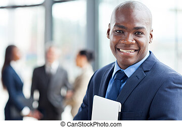 young african corporate worker in modern office with...
