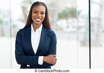 african american corporate worker standing in office -...