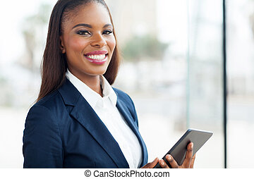 black businesswoman with tablet computer - cheerful black...