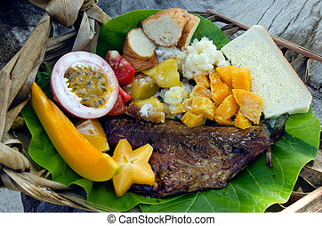 Tropical food dish in Aitutaki Lagoon Cook Islands -...