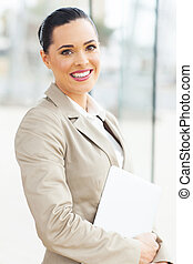 attractive office worker holding laptop computer