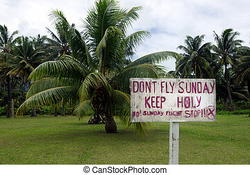 No Sunday Flights protesting sign in Aitutaki Lagoon Cook...