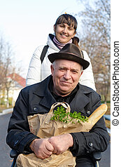 Smiling senior man with a bag of groceries - Smiling senior...