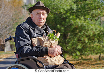 Handicapped man doing his grocery shopping - Senior...
