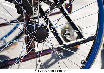 Spokes on the wheel of a wheelchair - Close up view of the...