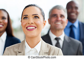 group of business people looking up - group of multiracial...