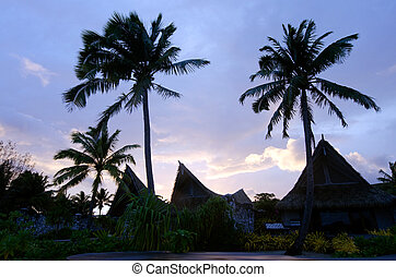 Beach Bungalows on Polynesian tropical Island - Silhouette...