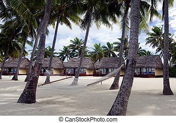 Beach Bungalows - Hammock and beach Bungalows on tropical...