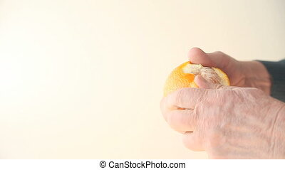 man peeling orange