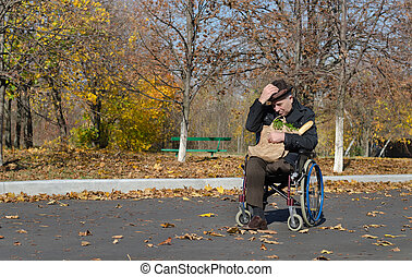 Lonely handicapped man in a wheelchair parked in the street...