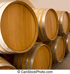 wine wooden oak barrels stacked in a row at winery