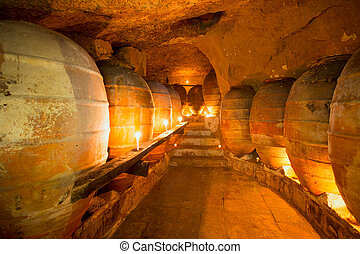 Antique winery in Spain with clay amphora pots - Antique...