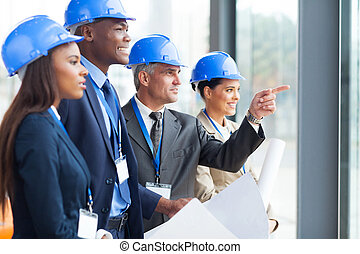 group of architects discussing project - group of successful...
