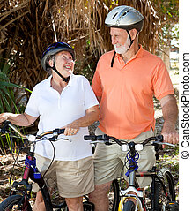Senior Cyclists In Love - Active senior couple with their...