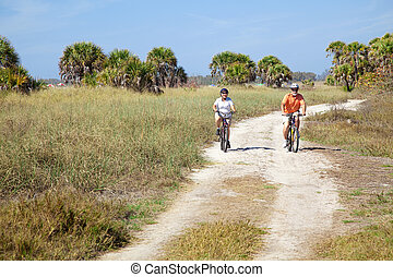 Seniors Riding Bikes at Beach