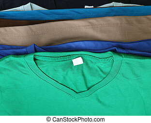 several colorful t-shirts - close up of several colorful...