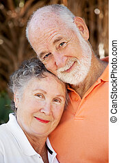 Loving Senior Couple - Closeup portrait of a beautiful...