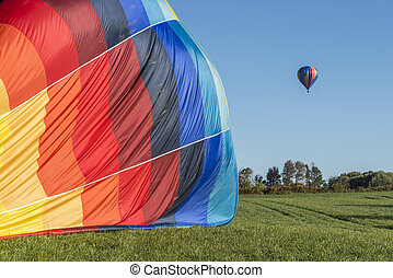 Hot Air Balloons - Hot Air Balloon Deflating While Another...