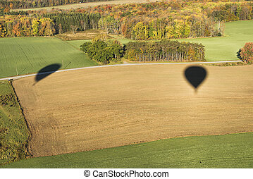 Side By Side - Shadows Of Two Hot Air Balloons Flying Side...