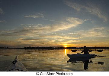 Kayaks at Sunset - Woman kayaking on Lake Ontario at sunset