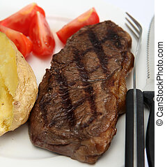 Broiled New York steak and veg - A grilled New York,...