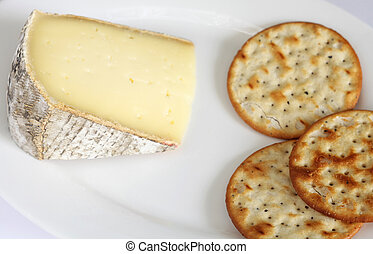 Cheese and biscuits - A wedge of French low fat Tomme de...