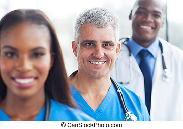 senior doctor and colleagues - portrait of senior doctor and...