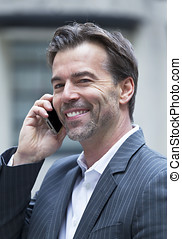 Successful Man Smiling On The Phone - Successful Businessman...