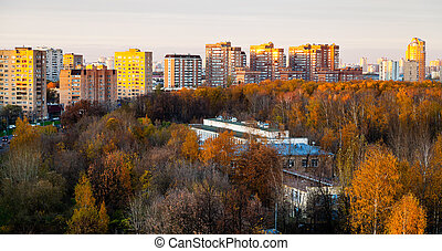 panoramic view of urban residential district in pink autumn...