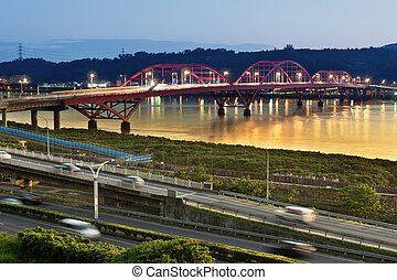 Urban day to night, famous Guandu Bridge in Taipei, Taiwan,...