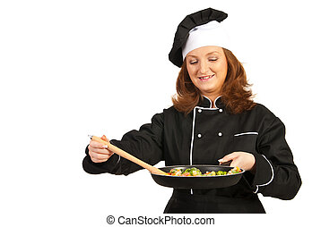 Chef woman preparing food in frying pan isolated on white...